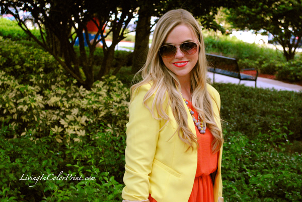 yellow blazer, orange dress, sunburst necklace