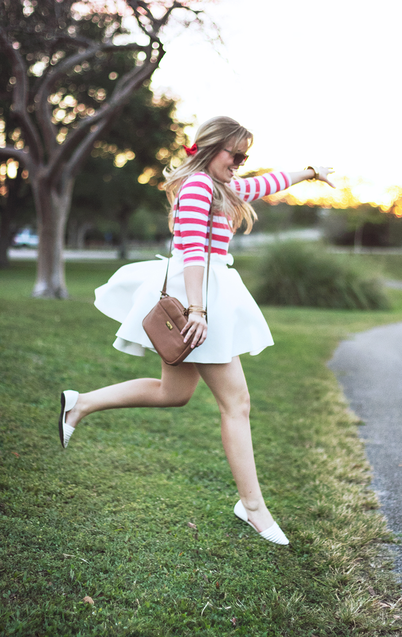 jumping-off-hill-red-stripes-white-skirt