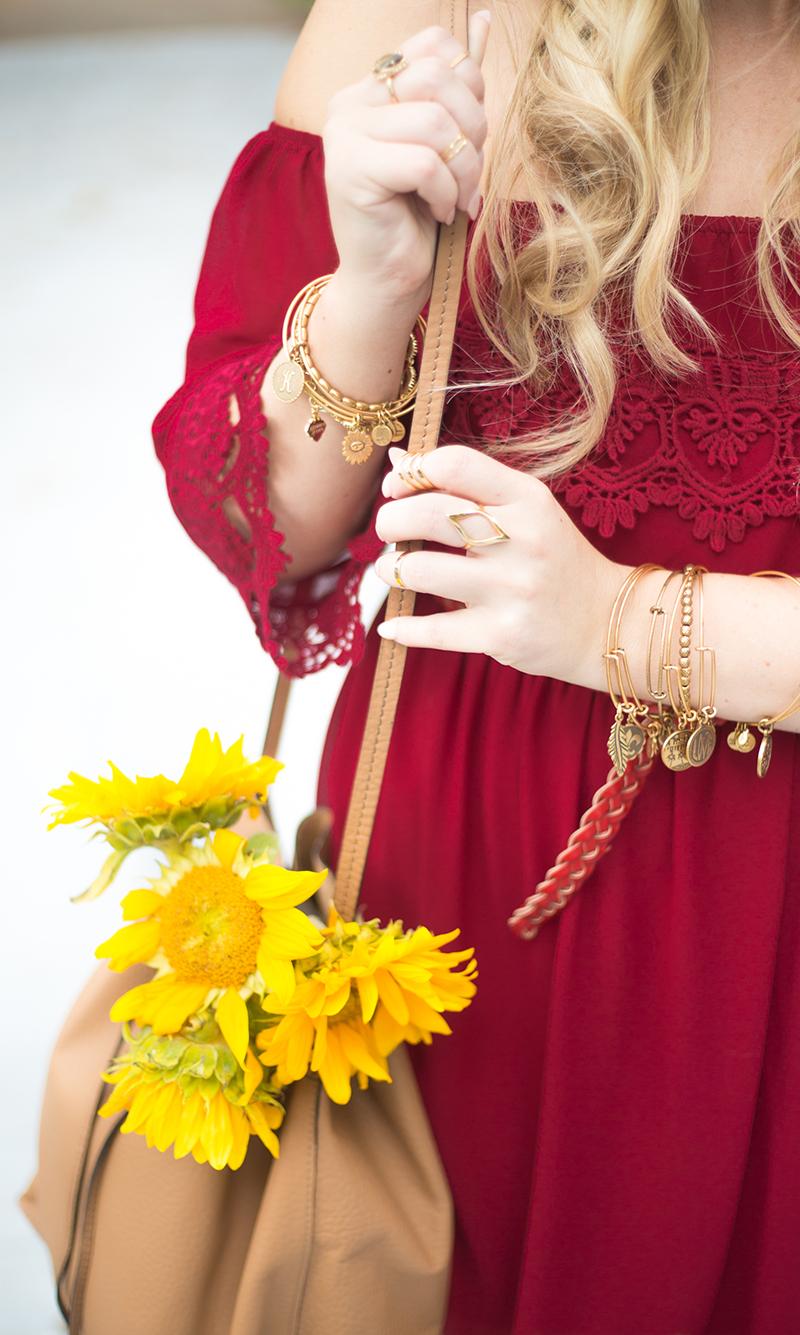 red-dress-cognac-bucket-bag-sunflowers