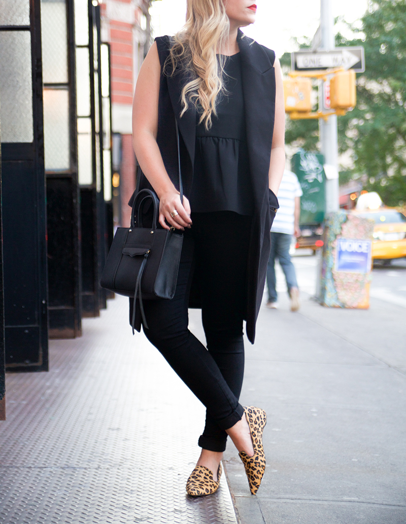 black sleeveless trench and leopard flats
