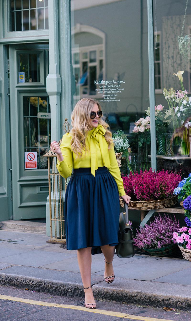 navy pleated skirt, citron bow blouse