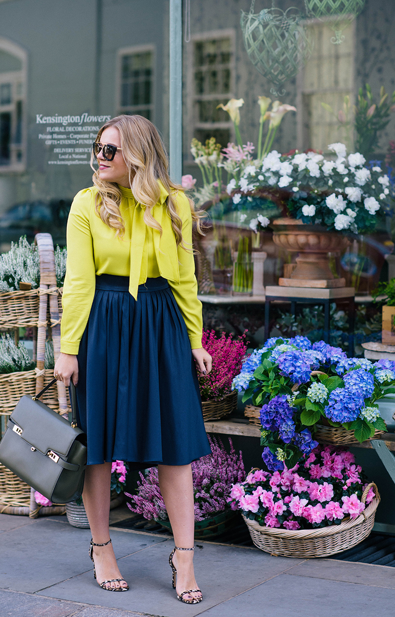 navy pleated skirt, citron bow blouse