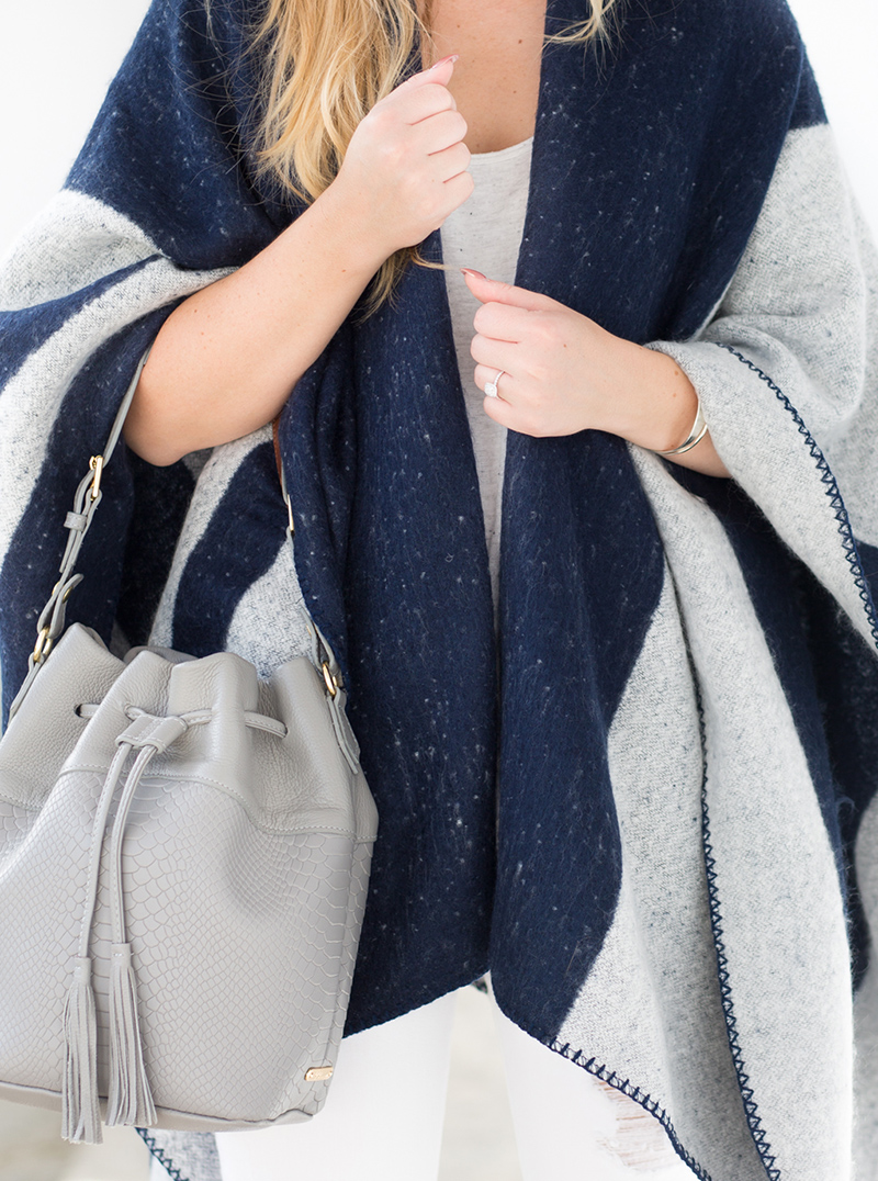 navy and grey poncho, white ripped denim for fall
