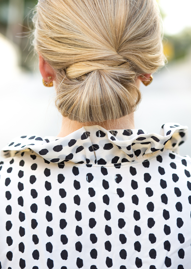 ruffled dotted blouse, low blonde chignon