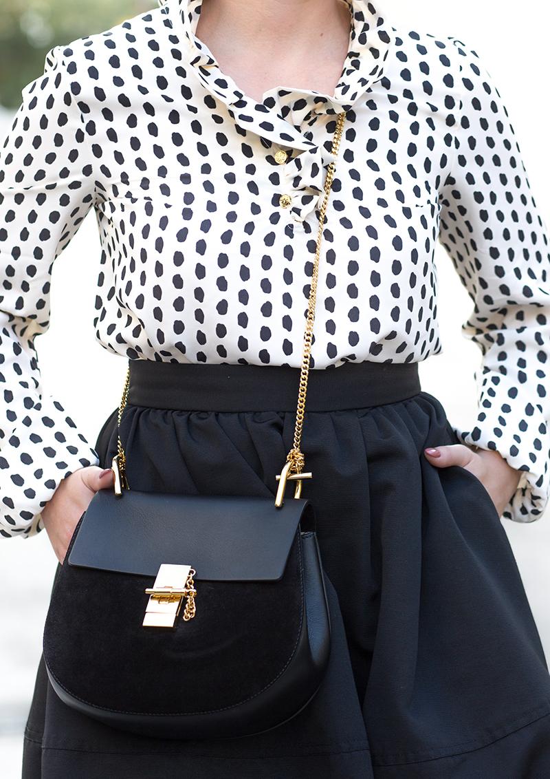 ruffled dotted blouse, black full skirt