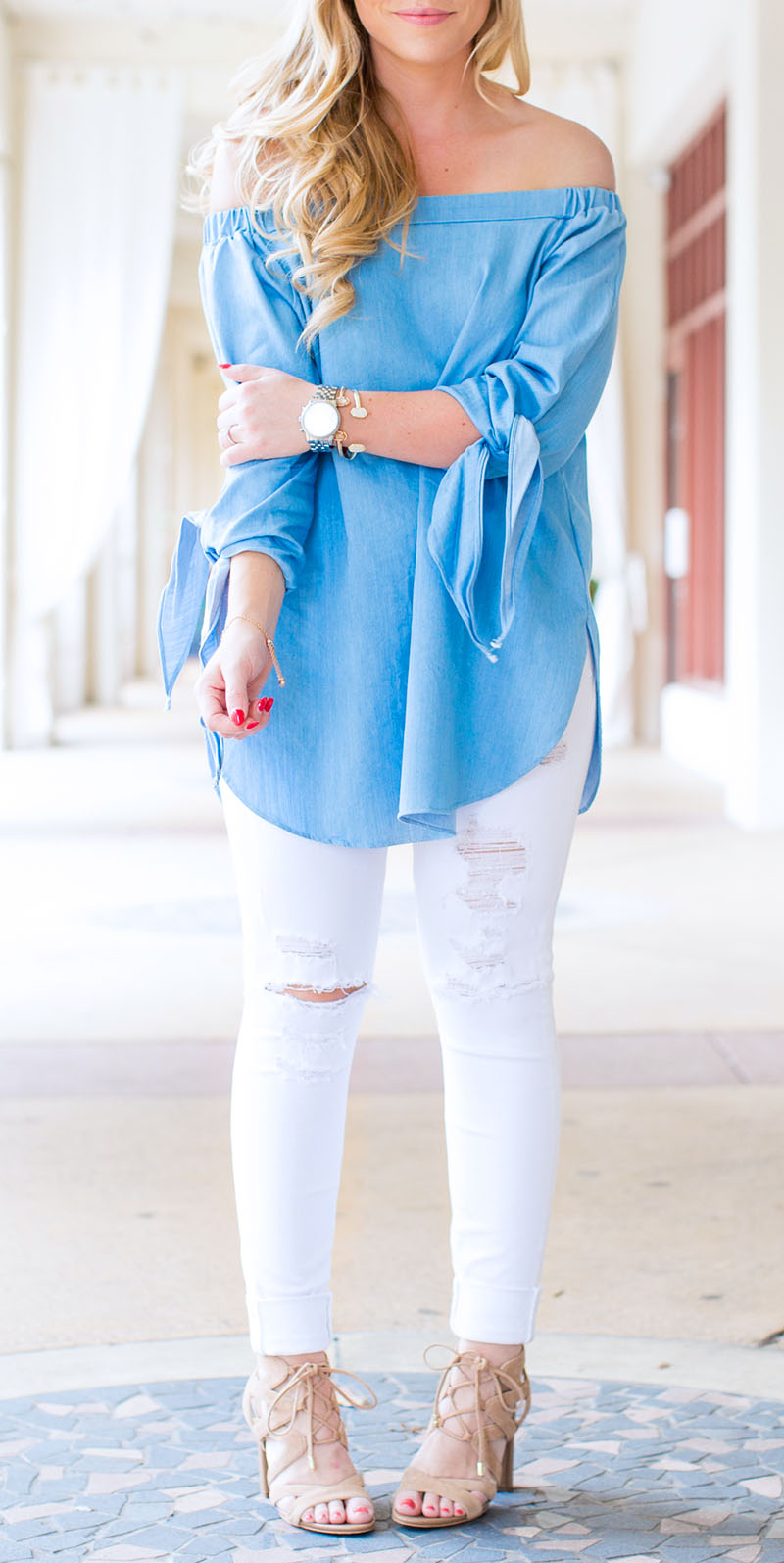 light blue off-the-shoulder tie sleeve top and white denim