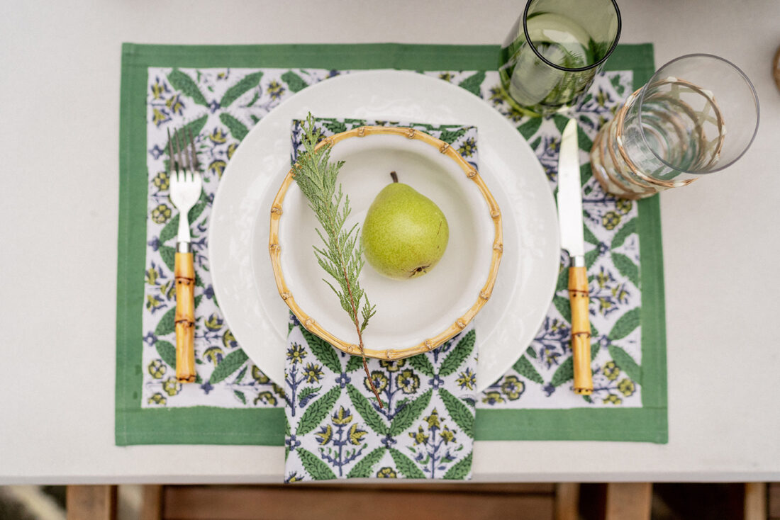 India Amory Green Holiday Linens, Bamboo Rim Bowls + Pear Place Settings
